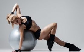 Sexy fitness girl with a ball