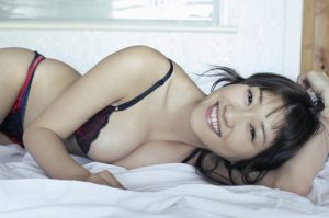 Attractive Asian girl in bed